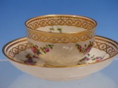 AN 18TH CENTURY TEA BOWL AND SAUCER, POSSIBLY DOCCIA, MOULDED IN RELIEF WITH CHERRY BLOSSOM SPRIGS