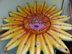 AN INTERESTING LARGE SMILING SUNFLOWER GARDEN ORNAMENT. Dia.92cms.