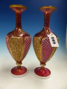A PAIR OF BOHEMIAN GLASS BALUSTER VASES, THE CRANBERRY BODIES OVERLAID WITH MILK GLASS PANELS