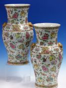 A PAIR OF CANTON BALUSTER VASES PAINTED WITH SCATTERED FLOWERS, FRUIT, BIRDS AND INSECTS, THE