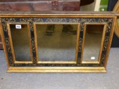 AN ANTIQUE THREE PLATE WALL MIRROR WITH GILT SCROLL AND EBONISED DECORATION. 73 X 43 CM