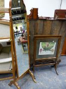 A 1930'S WALNUT FRAME CHEVAL MIRROR TOGETHER WITH A MAHOGANY GLAZED FIRESCREEN. (2)