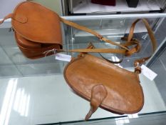 TWO INDIAN LEATHER CARTRIDGE BAGS.