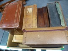 A COLLECTION OF EIGHT OLD SUITCASES OF VARIOUS SIZES.