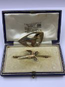 A CASED 9ct GOLD AND ENAMEL PHEASANT BROOCH SIGNED JG & S TOGETHER WITH A 9ct GOLD OSPREY BROOCH