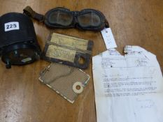 A ROBERTSON SUN-FLASH DISTRESS SIGNAL DEVICE, ACCOMPANYING 1991 LETTER, A PAIR OF FLYING GOGGLES AND