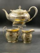 A SILVER HALLMARKED THREE PIECE TEA SET, THE TEAPOT DATED 1919 SHEFFIELD FOR ATKIN BROTHERS, THE