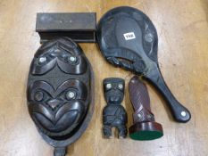 FIVE MAORI WOODEN ARTEFACTS INLAID WITH MOTHER OF PEARL ROUNDELS, TO INCLUDE: A CLUB, A FIGURE, A