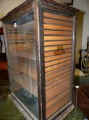 AN EARLY 20th.C.SHOP DISPLAY CABINET, THE SIDE GLASS PANELS DECORATED WITH FORD 428 MILL. 54 x 35