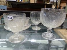 THREE CLEAR GLASS GOBLET SHAPED RUMMERS OR SERVING BOWLS, THE TALLEST. H 25.5cms TOGETHER WITH AN