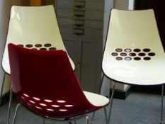 A SET OF FOUR CONNUBIA CALLIGARIS TWO TONE PLASTIC AND CHROME SIDE CHAIRS.