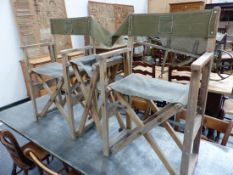 AN UNUSUAL FOLDING TRIPLE DIRECTOR TYPE CHAIR WITH CANVAS SEAT AND BACK.