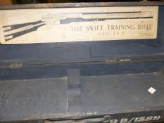 A RARE CASE FOR CARRYING A SERIES B SWIFT TRAINING RIFLE, ORIGINAL LABEL TO INSIDE OF LID.
