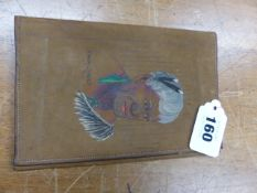 A WALLET, THE UNPOLISHED LEATHER PAINTED WITH THE HEAD OF A MAORI CHIEF NZ. 16.5 x 11cms.