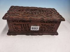 A CHINESE HARDWOOD BOX CARVED IN RELIEF WITH FIGURES IN VILLAGE SCENES, THE WAVY EDGED HINGED
