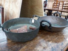 A VICTORIAN CAST BRASS JAM PAN WITH RING TURNED HANDLES AND ANOTHER WITH IRON HANDLES TOGETHER