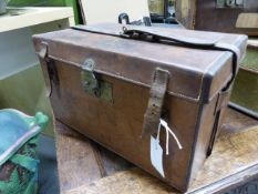 AN OAK AND LEATHER CARTRIDGE MAGAZINE BY J VENABLES. SHM TOGETHER WITH A BROWN LEATHER ON OAK