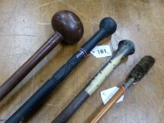 A SOUTH AFRICAN WOOD KNOBKERRIE TOGETHER WITH TWO AFRICAN STAFFS AND A SHOTGUN CLEANING ROD