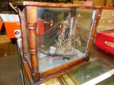 AN INTRIGUING GLAZED PINE CASED MODELOF A BRITISH TWO MASTED SHIP, THE RED AND BLACK HULL FORMED