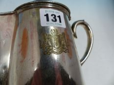 AN EBERSON SILVER PLATE LIDDED JUG BEARING THE ARMORIAL OF THE KIT CAT CLUB RESTAURANT. H 17cms