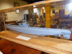 A SCALE MODEL OF A SUBMARINE HMS AMPHION (P439) WITH SPEC. DETAIL. HOUSED IN PERSPEX AND OAK BOUND