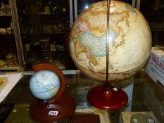 A REPLOGLE TWELVE INCH TERRESTIAL GLOBE TOGETHER WITH A 12cms DIAMETER ENGLISH GLOBE FOR THE