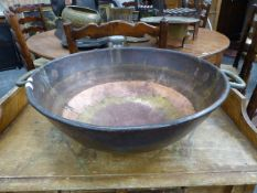 A LRGE 19th.C.COPPER BOWL WITH BRASS HANDLES DATED 1834. Dia.53cms.