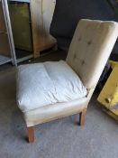 AN ART DECO LOW NURSING CHAIR WITH FEATHER CUSHIONS TOGETHER WITH A SIMILAR LATER CHAIR. (2)