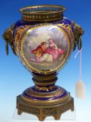 A SEVRES STYLE ORMOLU MOUNTED OIL LAMP BASE PAINTED ON ONE SIDE OF THE LION MASK AND RING HANDLES