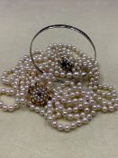 A TWO ROW GRADUATED CULTURED PEARL CHOKER FITTED WITH A 9ct GOLD PEARL AND GEMSET CLASP TOGETHER
