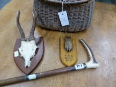 A SILVER MOUNTED HORN HANDLED WHIP, LONDON 1904, A FISHERMAN'S CREEL, A 1950 SHIELD MOUNTED OTTER'