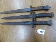 THREE WILKINSON LONDON BAYONETS, ONE BLADE CLEARLY STAMPED ER AND ONE WOODEN HANDLE GRIP STAMPED 05.