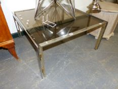 A PAIR OF 1970'S RETRO CHROME FRAMED COFFEE TABES WITH SMOKED GLASS TOPS. 70 x 70 x H.36cms.