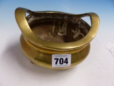 A CHINESE POLISHED BRONZE TWO HANDLED TRIPOD CENSER, TWO CHARACTER MARK WITHIN DRAGON ROUNDEL.