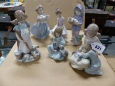 SIX LLADRO FIGURES OF GIRLS WITH CATS AND KITTENS, THE TALLEST. H 21.5cms