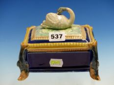 A 19th C. MAJOLICA SARDINE BOX, THE RECTANGULAR COVER WITH SWAN FINIAL, THE CORNERS OF THE BLUE BODY