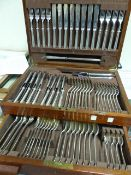 A MAHOGANY CASED CANTEEN OF HALLMARKED SILVER RATTAIL CUTLERY BY MAPPIN AND WEBB, SHEFFIELD 1957,