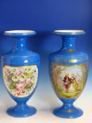 A PAIR OF FRENCH PORCELAIN TURQUOISE BLUE GROUND VASES PAINTED WITH GILT FOLIATE FRAMES OF COUPLES
