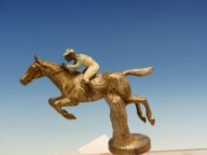 A VINTAGE CAR MASCOT IN THE FORM OF RACE HORSE OVER HURDLES WITH JOCKEY UP.