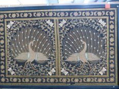 AN EASTERN EMBROIDERED METAL THREAD PANEL WITH APPLIQUED PEACOCKS SURROUNDED BY FOLIATE SCROLLS,