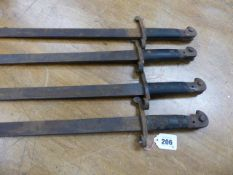 FOUR SIMILAR BAYONETS, ONE CLEARLY MARKED WILKINSON SWORD COMPANY AND /89, THE BLACK WOODEN HANDLE
