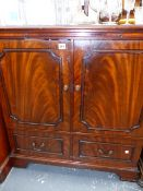 A TV CABINET.