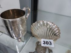 A HALLMARKED SILVER SHELL DISH AND A CHRISTENING CUP.