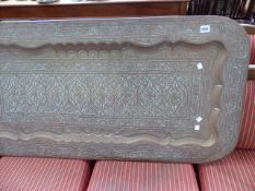 A LARGE EASTERN BRASS TRAY.