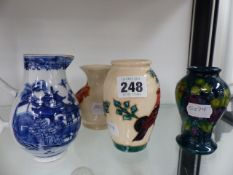 THREE MOORCROFT SMALL VASES AND A BLUE AND WHITE ORIENTAL JUG.