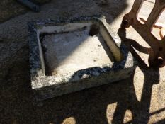A SMALL STONE SINK.