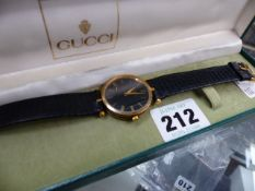 A VINTAGE GUCCI WATCH ON ORIGINAL BLACK LEATHER STRAP, COMPLETE WITH BOX.
