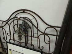 AN ANTIQUE BRASS AND IRON BED.