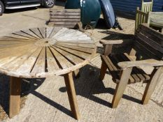 A CIRCULAR TEAK GARDEN TABLE AND A PAIR OF SIMILAR ARM CHAIRS.