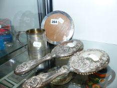 A PAIR OF HALLMARKED SILVER BRUSHES, PHOTO FRAME AND TANKARD.